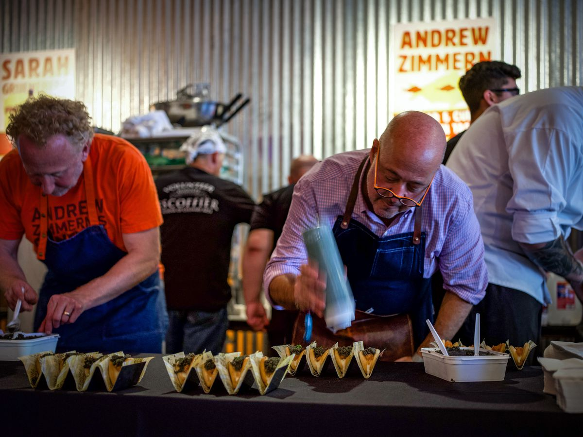 Andrew Zimmern prepping tacos at Rock Your Taco 2019
