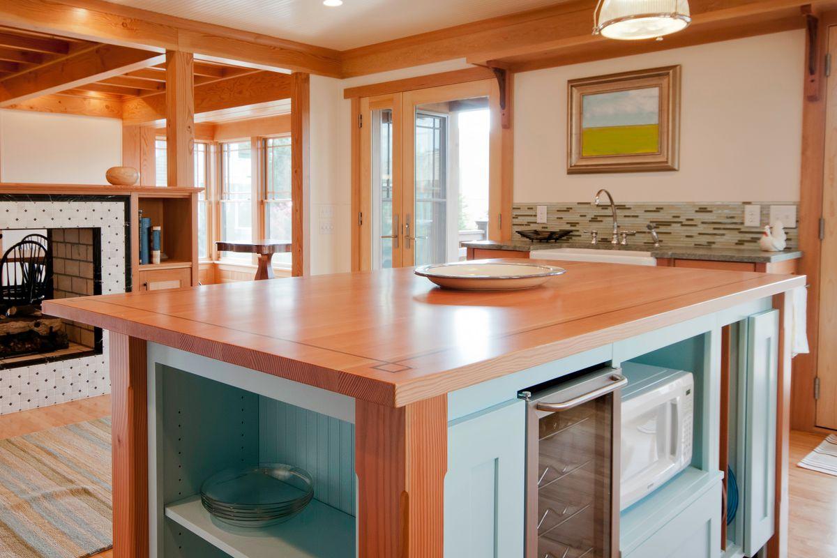 Wood countertop island in kitchen.