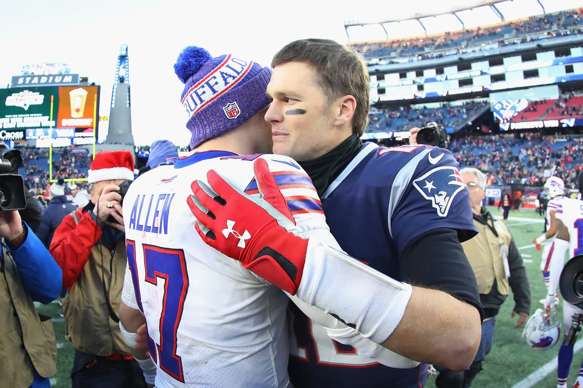 Quarterback Josh Allen of the Buffalo Bills and quarterback Tom Brady of the New England Patriots meet on the field after the Patriots defeated the Bills 24-12 at Gillette Stadium on December 23, 2018 in Foxborough, Massachusetts.