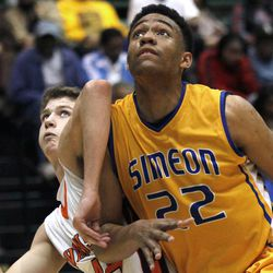 In this photo taken in Chicago, on Tuesday, March 13, 2012, Simeon Career Academy's forward Jabari Parker muscles his way through a block out attempt by Evanston High School forward Matt Munro during an Illinois state basketball super-sectional game. Lola Parker, Jabari's mother, realized Jabari, had a special talent when he was in the second grade and going against fourth and fifth-graders in his father's league. She saw how advanced his footwork was, and she told her husband that their son needed to be challenged, even if that meant taking a beating against the older kids.