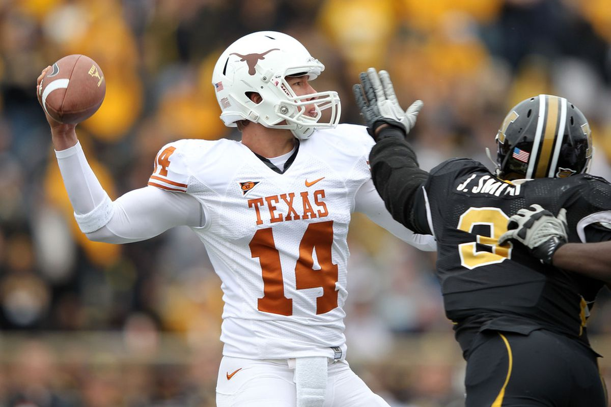 COLUMBIA, MO - NOVEMBER 12:  Quarterback David Ash #14 of the Texas Longhorns passes during the game against the Missouri Tigers on November 12, 2011 at Faurot Field/Memorial Stadium in Columbia, Missouri.  (Photo by Jamie Squire/Getty Images)