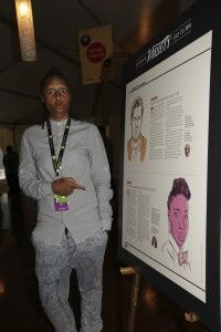 Lena Waithe checks out her write-up as one of Variety's 10 Comics to Watch at a 2014 party in Montreal.   Pierre Roussel/Getty Images