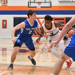 New Trier's Noah Osher (2) tries to cut off the lane from Curie's DaJuan Gordon (3), Friday 12-28-18. Worsom Robinson/For Sun-Times