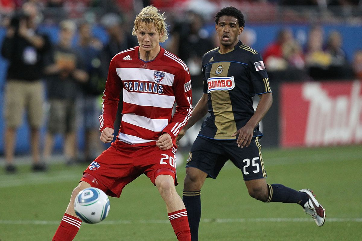 FRISCO, TX - MAY 14:  Brek Shea #20 of FC Dallas dribbles the ball against Sheanon Williams #25 of the Philadelphia Union at Pizza Hut Park on May 14, 2011 in Frisco, Texas.  (Photo by Ronald Martinez/Getty Images)
