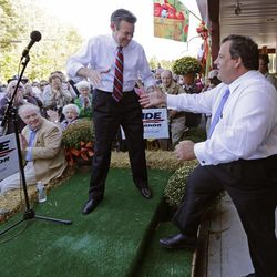 New Jersey Gov. Chris Christie, right, shakes hands with New Hampshire Republican gubernatorial candidate Ovide Lamontagne as he is introduced to speak in Atkinson, N.H., Tuesday, Sept. 25, 2012.  Christie said electing Lamontagne as New Hampshire's governor is the only way to ensure the state doesn't end up with an income tax.