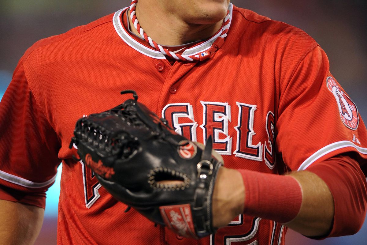 Sep 10, 2012; Anaheim, CA, USA; Los Angeles Angels center fielder Mike Trout (27) runs into the dugout during the game against the Oakland Athletics during the first inning at Angel Stadium of Anaheim. Mandatory Credit: Kelvin Kuo-US PRESSWIRE