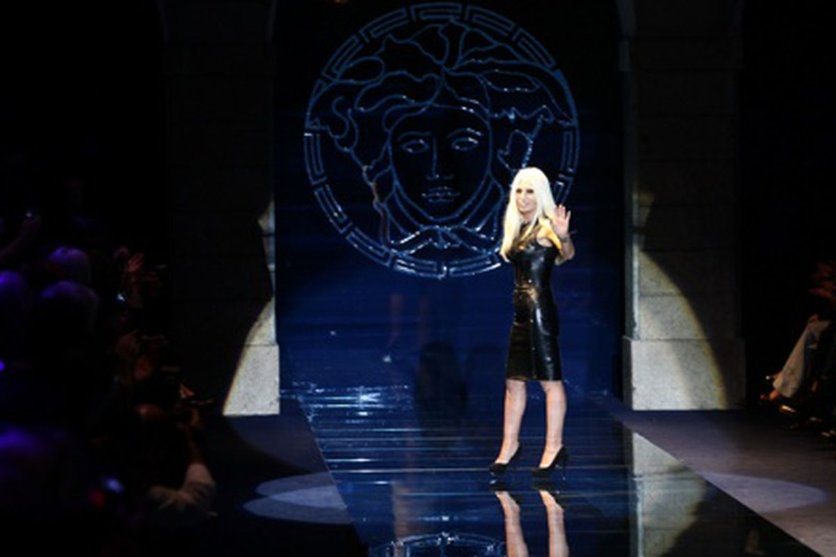 Donatella Versace at her Autumn/Winter 2012/2013 show, via Getty