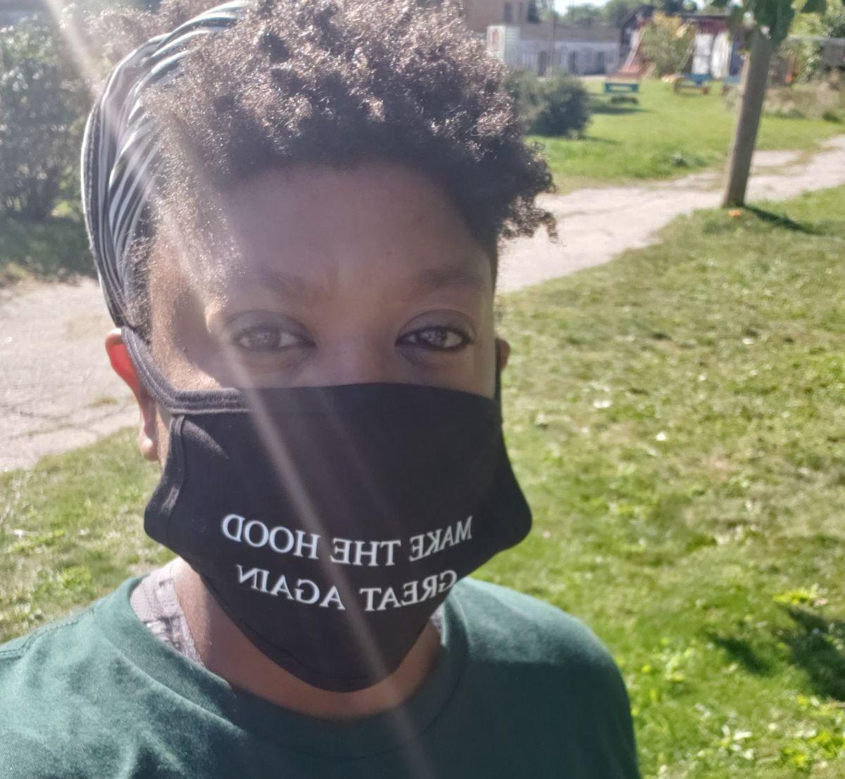 Ederique Goudia wears her Make the Hood Great Again mask.