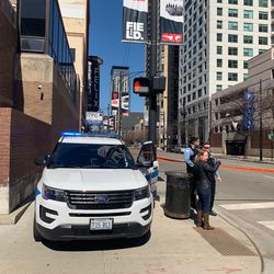 Police cordon off a stretch of Clark Street Saturday afternoon.   Sam Kelly/Sun-Times