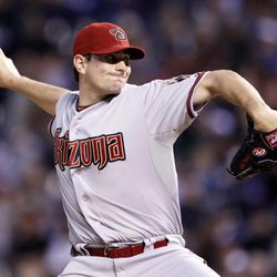 Arizona Diamondbacks starting pitcher Daniel Hudson throws to the plate against the Colorado Rockies during the first inning of a baseball game on Friday, April 13, 2012, in Denver.