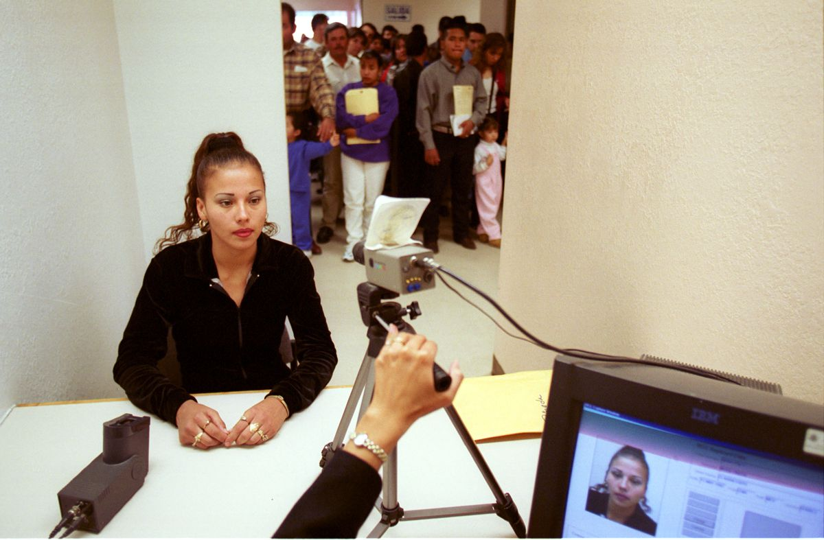A woman has her photo taken for a visa at the US Consulate in Ciudad Juarez.