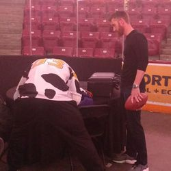 Kyle Rudolph autographing a jersey for one of Marty Smith's children.