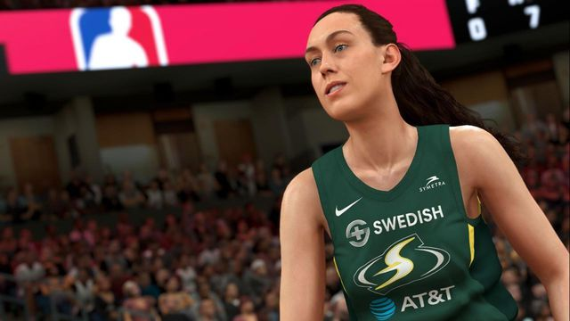Closeup of WNBA star Breanna Stewart in uniform with a crowd in the background.