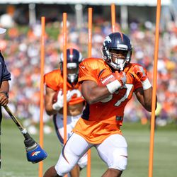 Broncos rookie RB Royce Freeman works back and forth through poles.