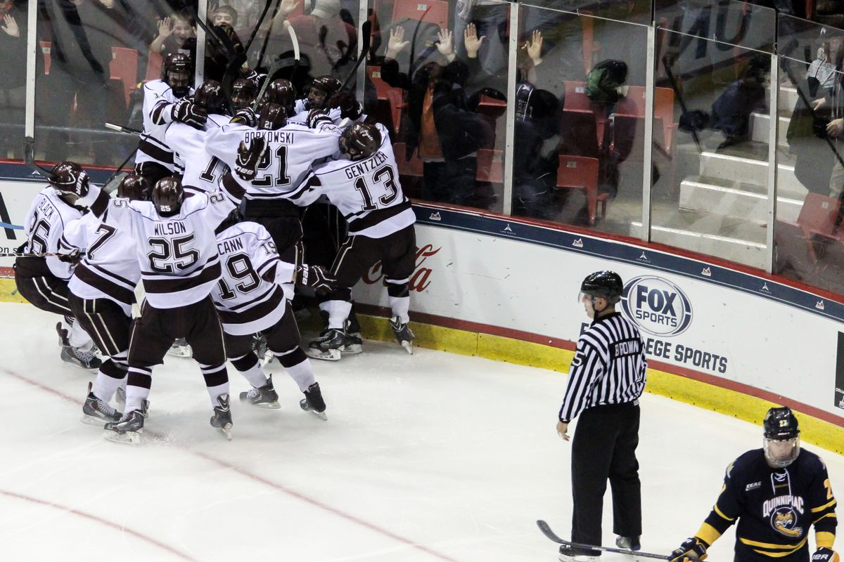 Colgate players celebrate their overtime victory over Quinnipiac in the 2014 ECAC Hockey Semifinals.