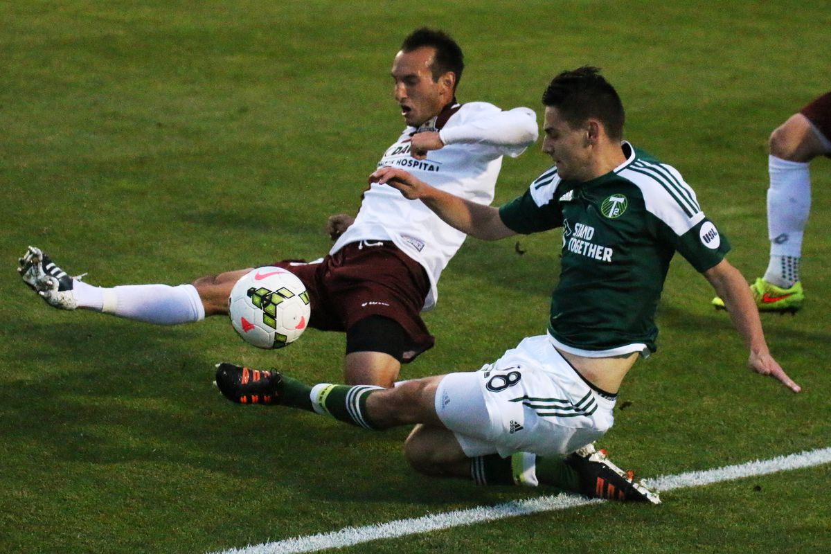 Thoma slides to send the ball into the box in the first half against Sacramento Republic on April 2, 2015.