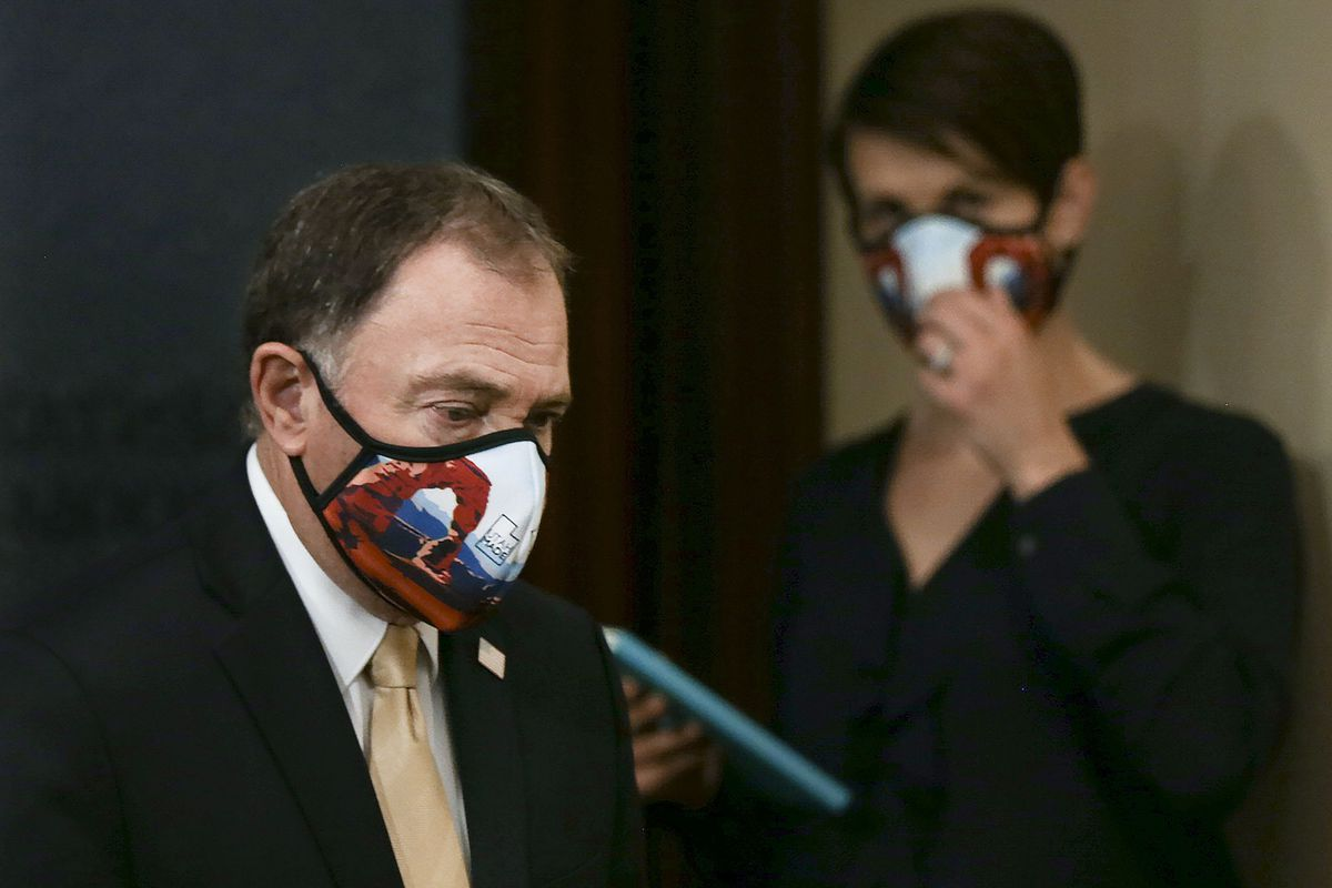Gov. Gary Herbert, left, walks to the microphone as Dr. Angela Dunn, state epidemiologist with the Utah Department of Health, looks on during the daily COVID-19 briefing at the Capitol in Salt Lake City on Thursday, May 14, 2020.