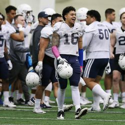 Brigham Young Cougars defensive lineman Sione Takitaki (16)  cheers a good defensive play during an intersquad scrimmage in Provo on Friday, March 23, 2018.