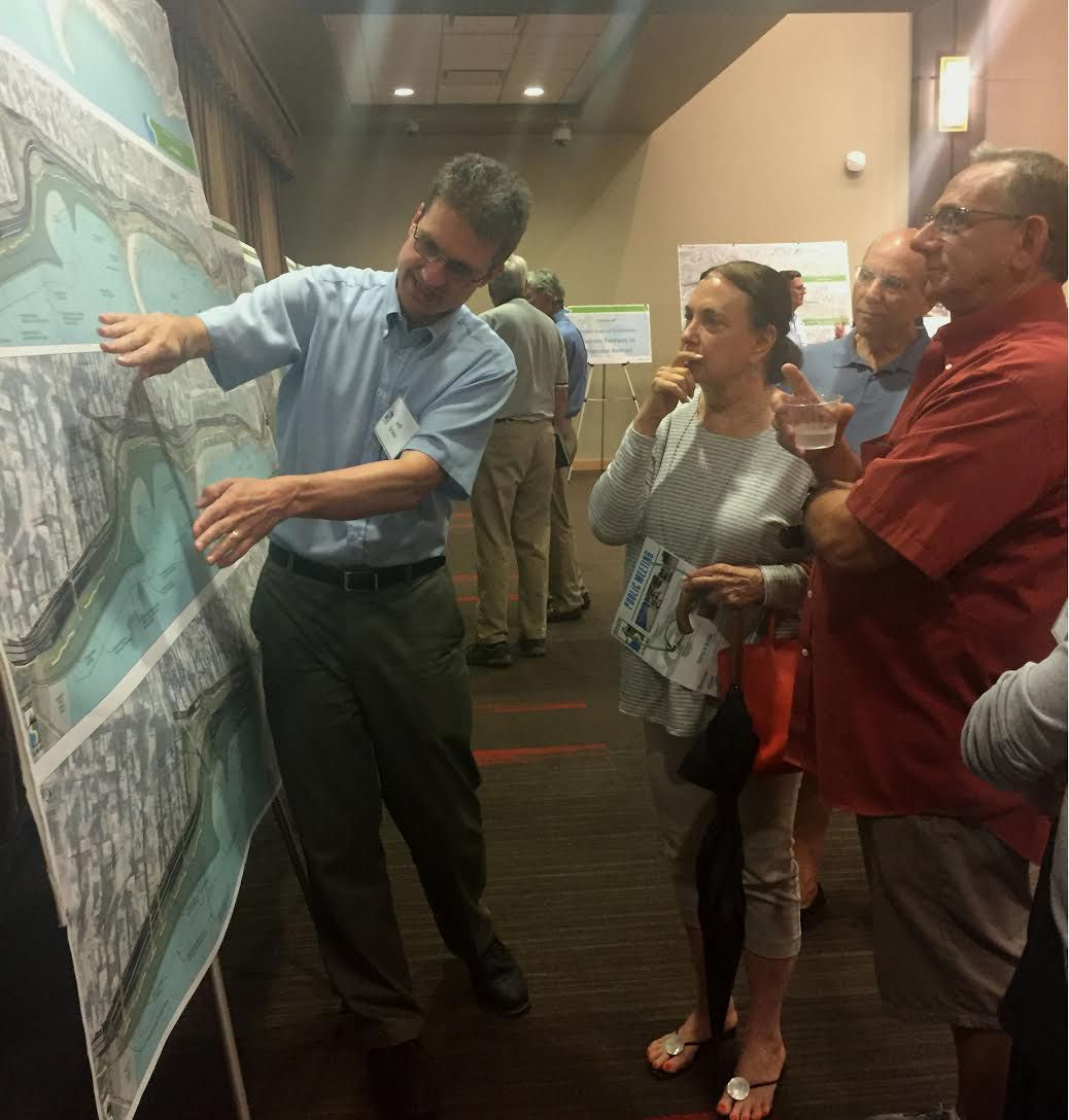 Chicago Department of Transportation's Jeff Sriver, and Chicago residents Diane Gottlieb (center) and Doug Saleeby talk about potential plans to improve North Lake Shore Drive. | Rachel Hinton | Sun-Times