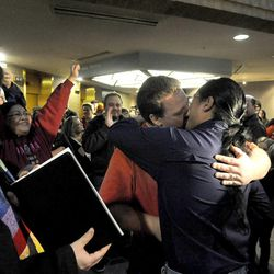 Michael Andrus, in red, kisses his husband, James Dinh, after being married by the Rev. Curtis Price in the Salt Lake County offices after a federal judge ruled that Amendment 3, Utah's same-sex marriage ban, is unconstitutional on Friday, Dec. 20, 2013.