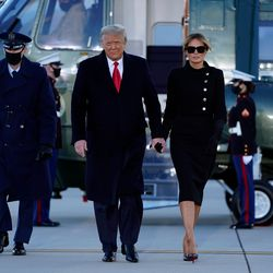 Outgoing US President Donald Trump and First Lady Melania Trump walk from Marine One at Joint Base Andrews in Maryland on January 20, 2021. - President Trump travels his Mar-a-Lago golf club residence in Palm Beach, Florida, and will not attend the inauguration for President-elect Joe Biden.