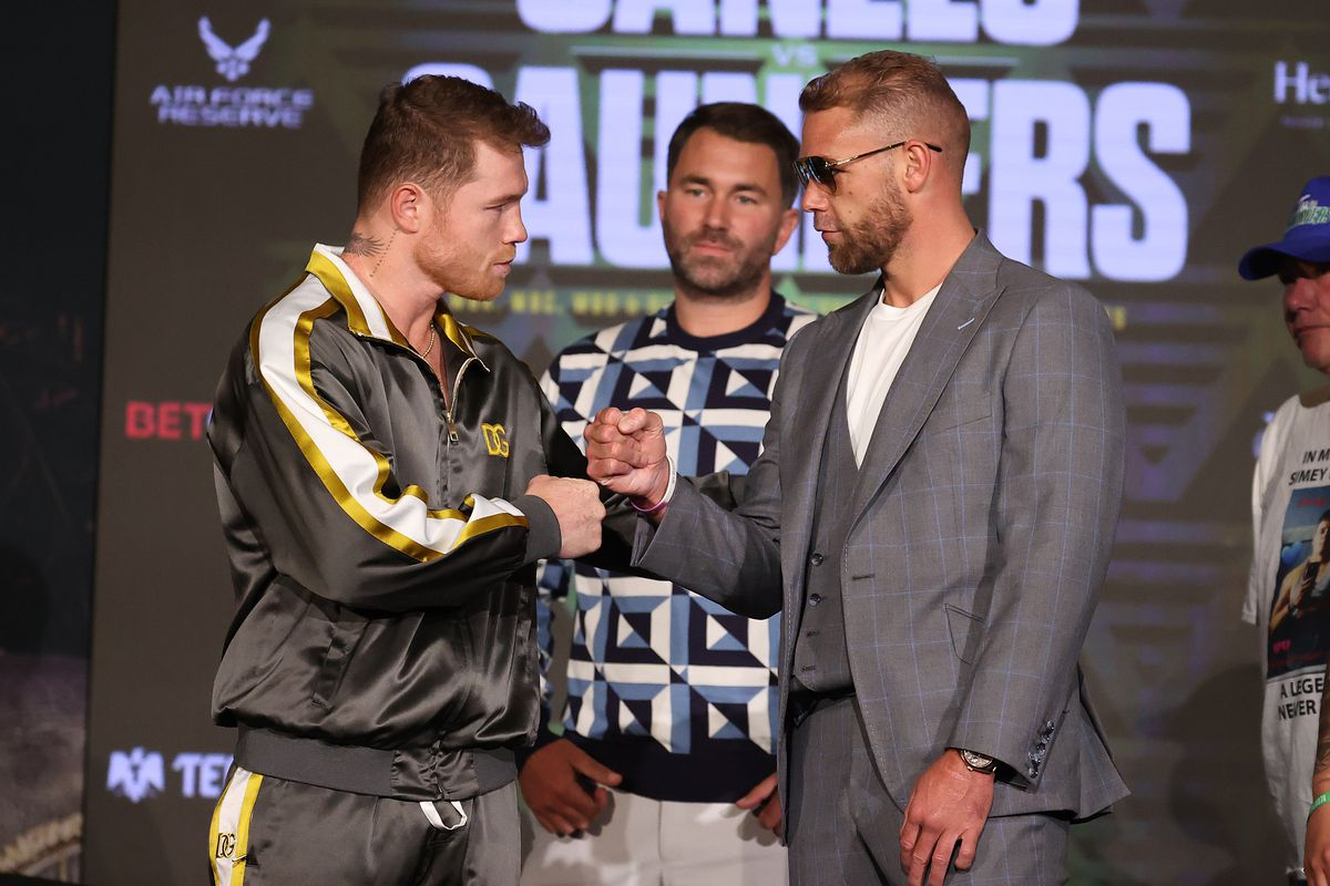 Canelo Alvarez and Billy Joe Saunders shake hands with Matchroom Promoter Eddie Hearn looking on during the press conference for Alvarez's WBC and WBA super middleweight titles and Saunders' WBO super middleweight title at Live! by Loews hotel on May 06, 2021 in Arlington, Texas.