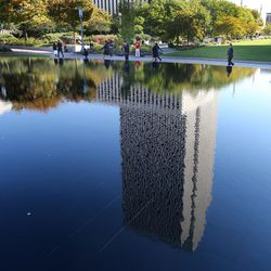 Reflection of the Church Office Building during the opening session of the 183rd Semiannual General Conference of The Church of Jesus Christ of Latter-day Saints on Saturday, Oct. 5, 2013, in Salt Lake City.