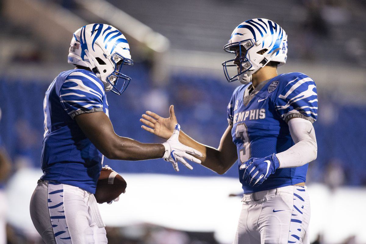 Brady White of the Memphis Tigers congratulates Sean Dykes on their touchdown pass during the third quarter against the Arkansas State Red Wolves at Liberty Bowl Memorial Stadium on September 5, 2020 in Memphis, Tennessee. Memphis defeated Arkansas State 37-24.