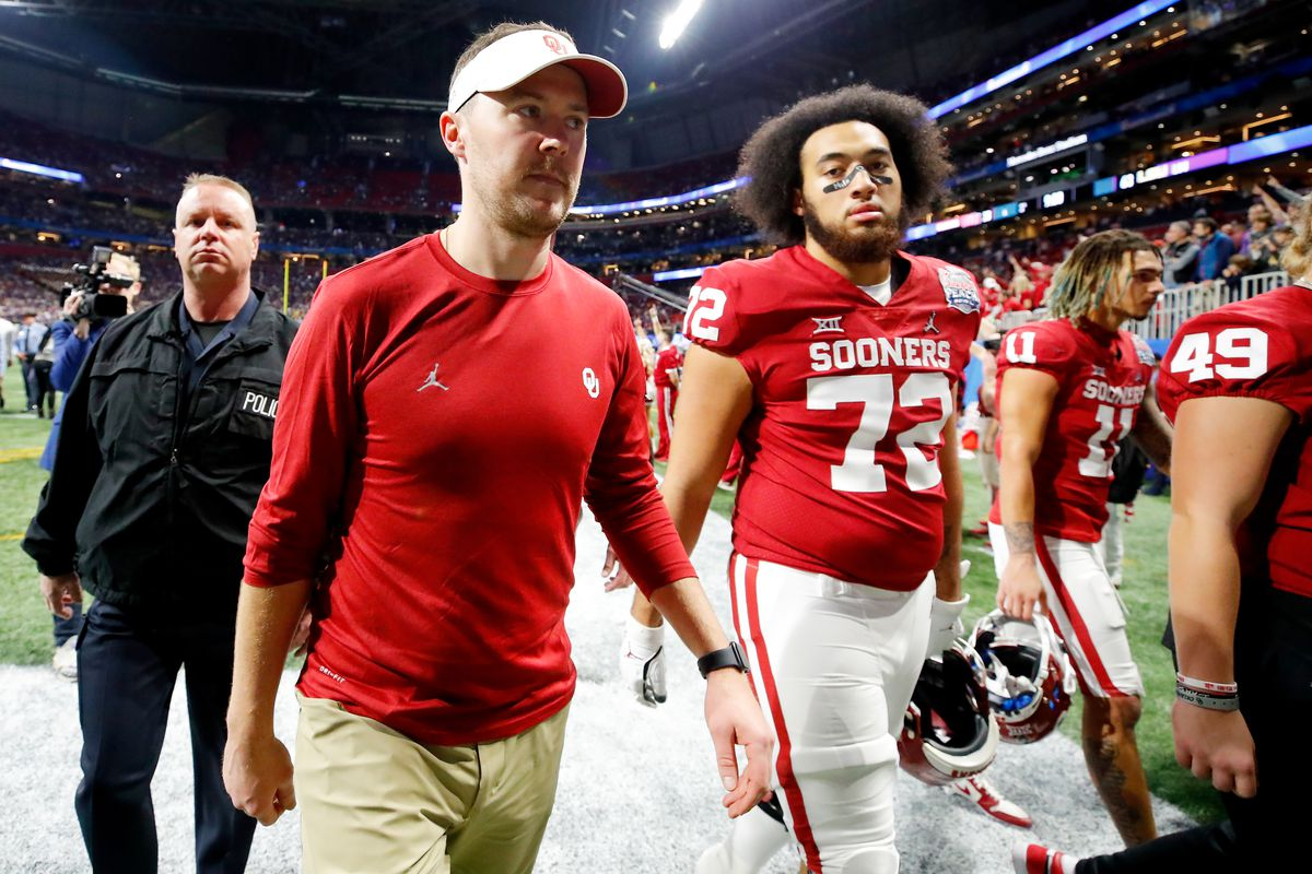 Head coach Lincoln Riley of the Oklahoma Sooners walks off the field after the LSU Tigers win the the Chick-fil-A Peach Bowl 28-63 at Mercedes-Benz Stadium on December 28, 2019 in Atlanta, Georgia.