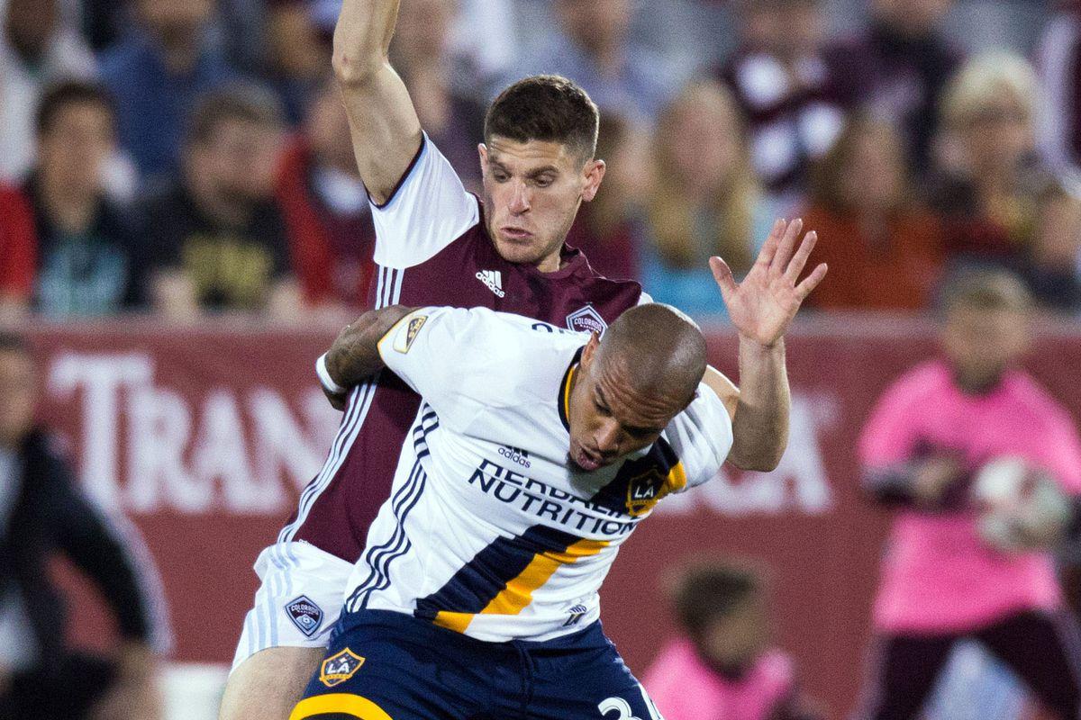 Dillon Power battles Galaxy midfielder Nigel de Jong.