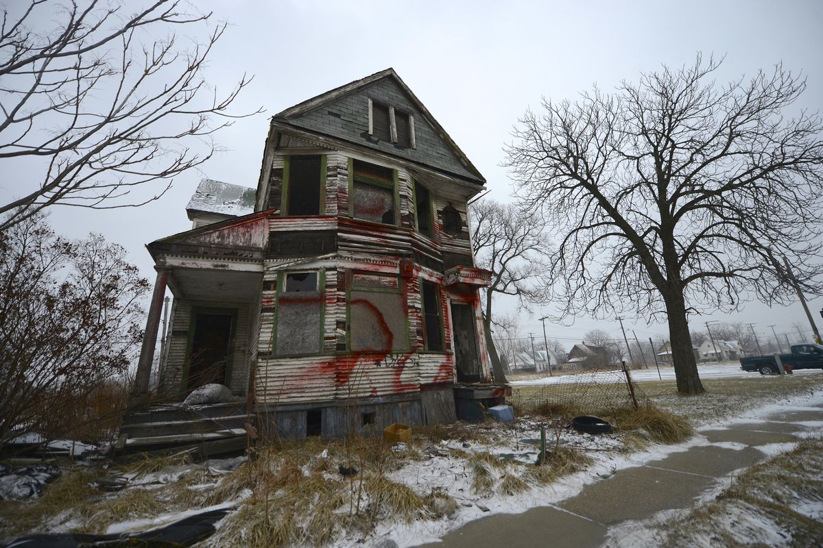One of Detroit's tens of thousands of abandoned and deteriorating homes stands empty.