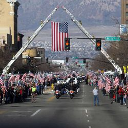 The motorcade makes it way through the huge crowds of supporters as they line up along Washington Blvd., while the casket of Ogden officer Jared Francom makes its way to the Ogden Cemetery in Ogden Wednesday, January 11, 2012.
