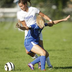 Bingham's Whitney Daniels and Pleasant Grove's Lucy Borland compete for the ball  in prep soccer in Salt Lake County Thursday, Sept. 13, 2012.