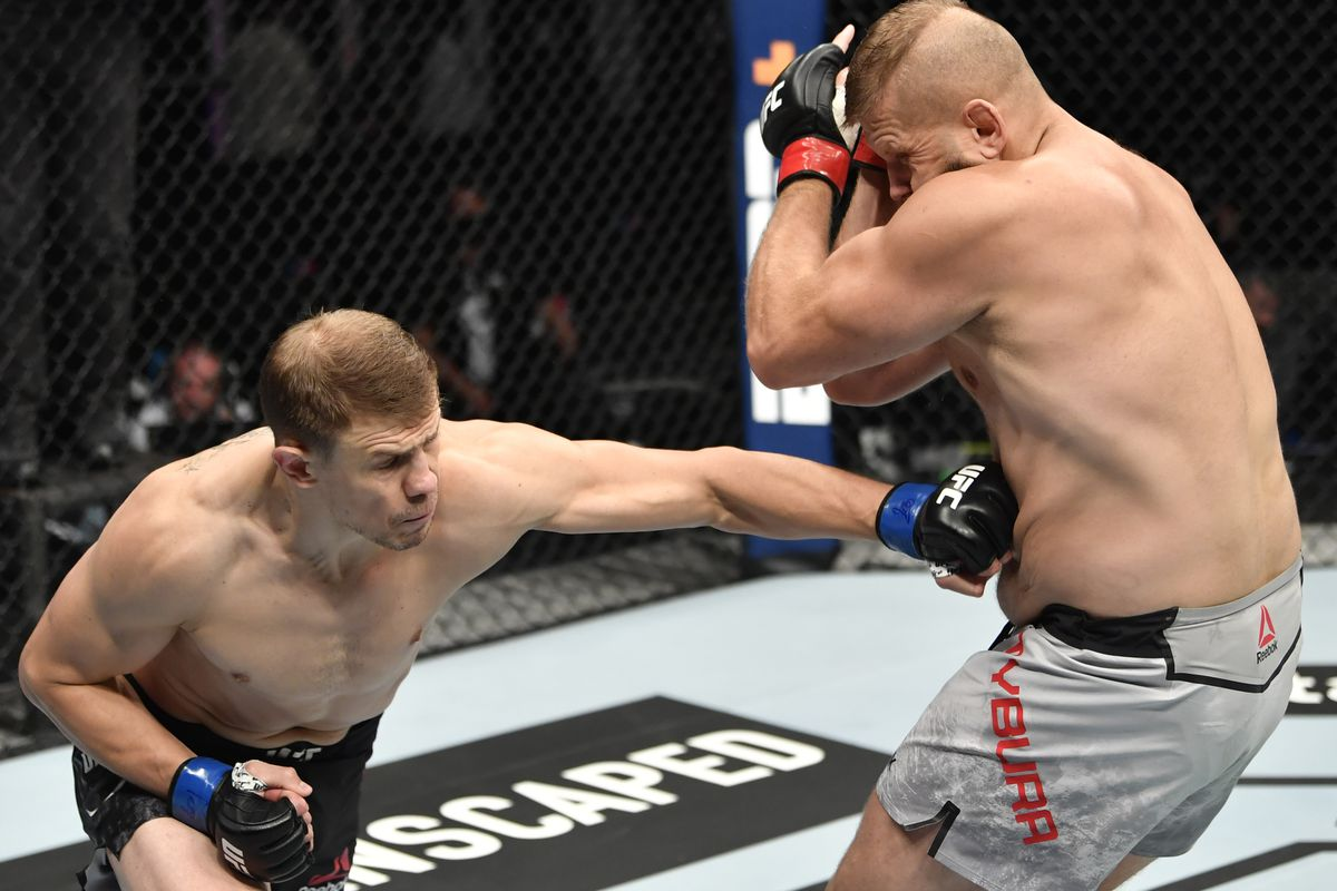 Maxim Grishin of Russia punches Marcin Tybura of Poland in their heavyweight fight during the UFC 251 event at Flash Forum on UFC Fight Island on July 12, 2020 on Yas Island, Abu Dhabi, United Arab Emirates.