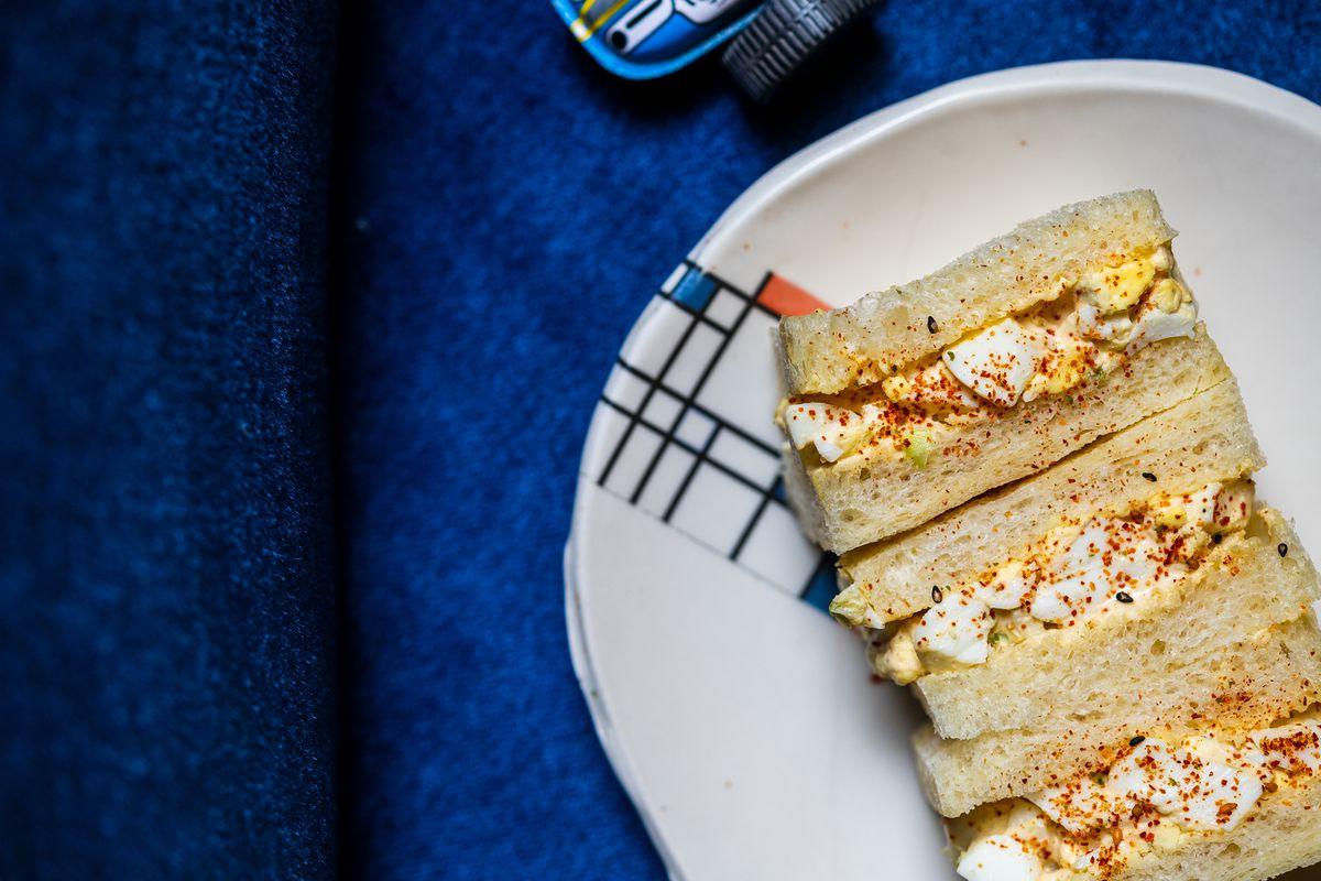 An egg salad sando on crustless milk bread from Cafe Spoken