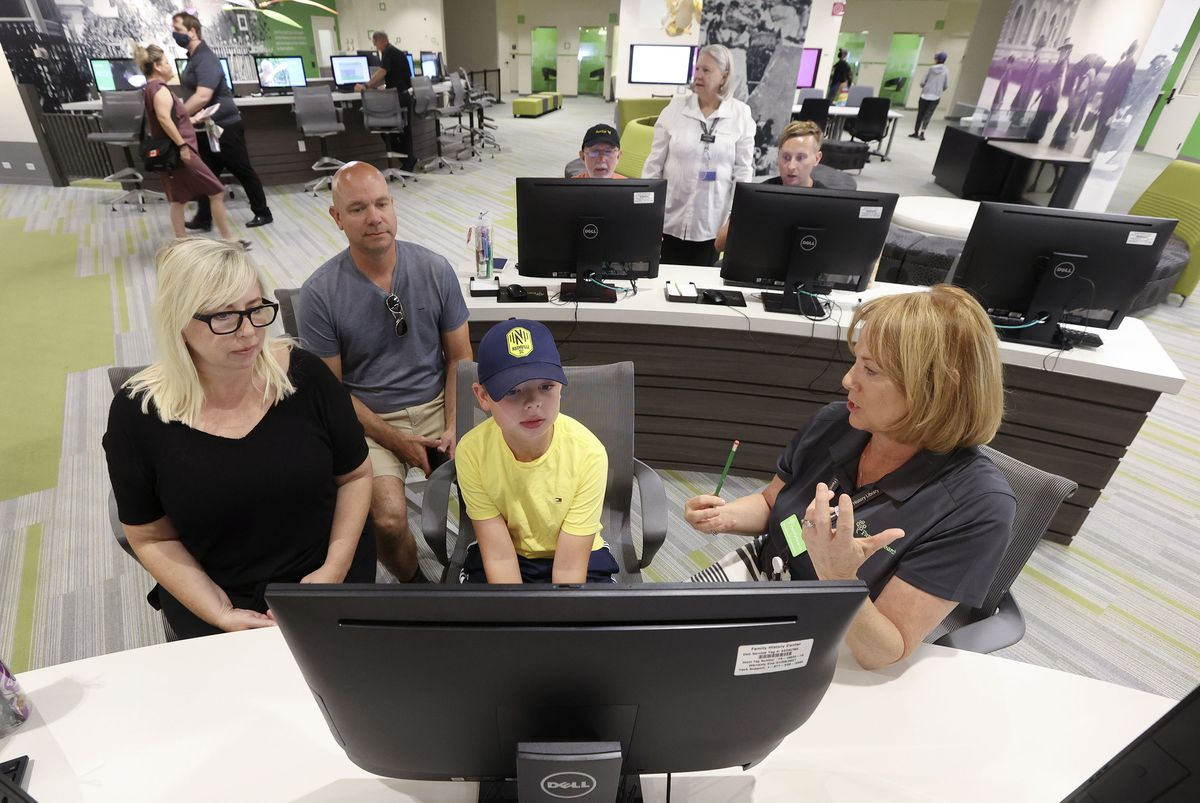 Vanessa Newton, left, Lee Newton, and Brice Newton get help creating a FamilySearch account for Brice with Diane Gomm at the Family History Library at The Church of Jesus Christ of Latter-day Saints in Salt Lake City on Tuesday July 6, 2021. The library reopened after being closed for 16 months.