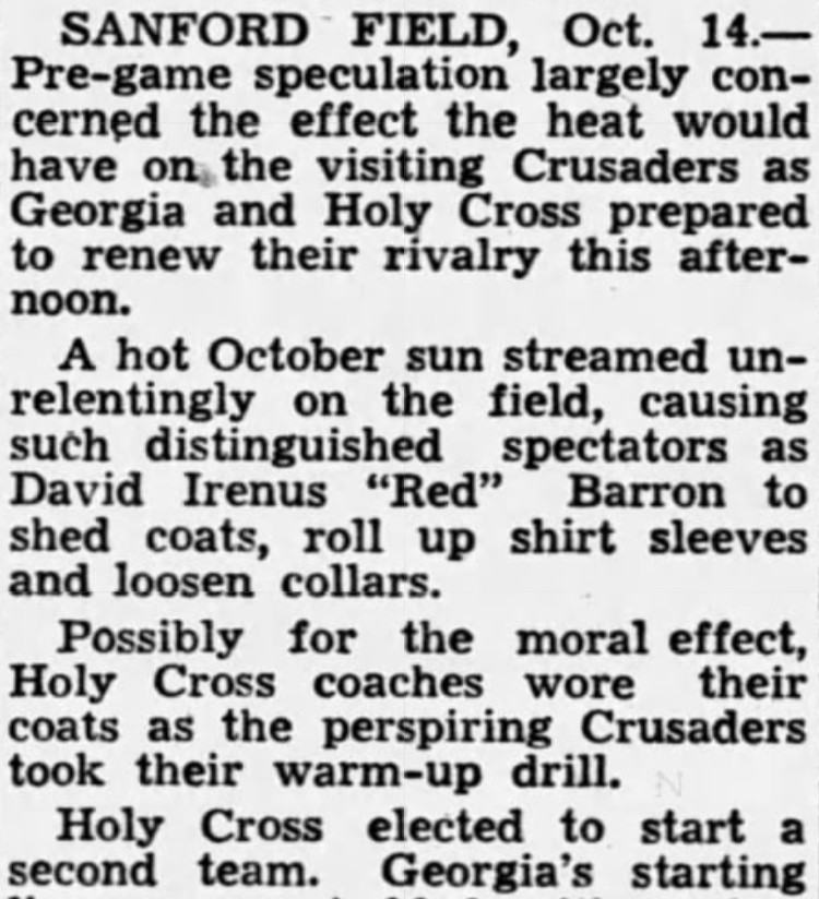 """""""Holy Cross coaches wore their coats as the perspiring Crusaders took their warm-up drill."""""""