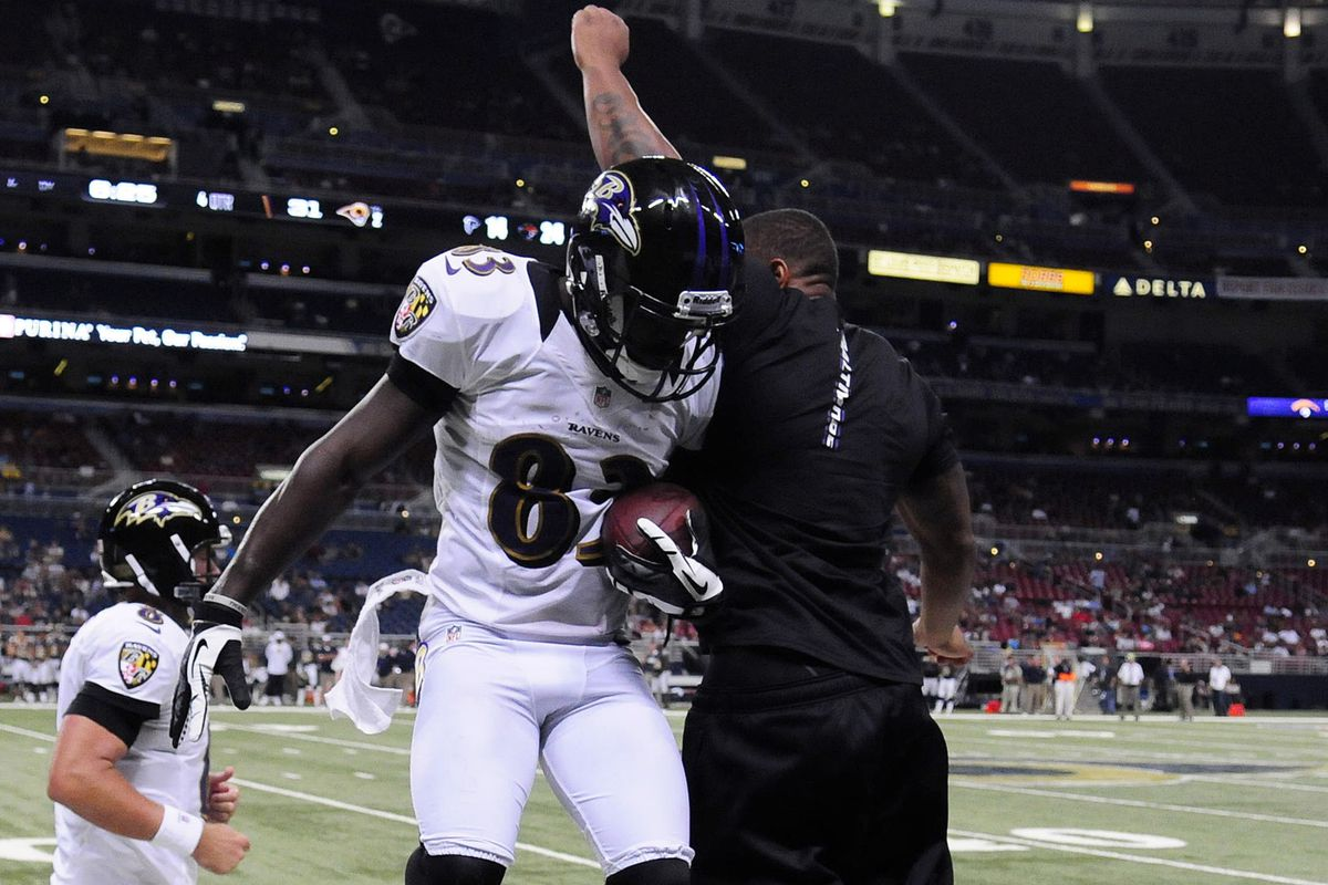 WR Deonte Thompson celebrates a TD with RB Ray Rice during a preseason game versus the St. Louis Rams.