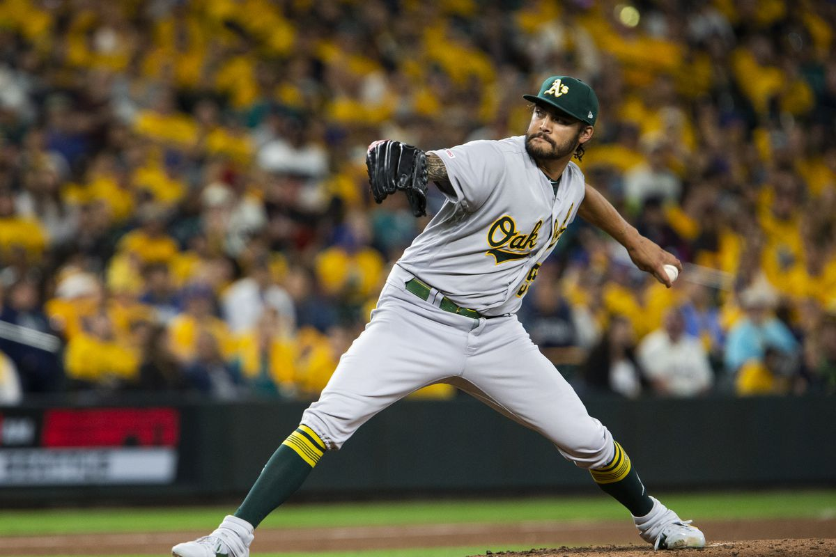 Oakland Athletics starting pitcher Sean Manaea winds up and pitches in the third inning at T-Mobile Park on September 26, 2019 in Seattle, Washington.