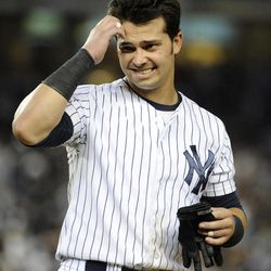 New York Yankees' Nick Swisher scratches his head after striking out off Baltimore Orioles relief pitcher Darren O'Day in the eighth inning of a baseball game on Friday, Aug., 31, 2012, at Yankee Stadium in New York.