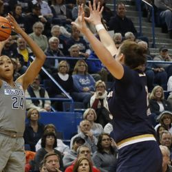 UConn's Napheesa Collier (24) attempts a three-pointer over /Notre Dame's Jessica Shepard (23) during the Notre Dame Fighting Irish vs UConn Huskies women's college basketball game in the Women's Jimmy V Classic at the XL Center in Hartford, CT on December 3, 2017.