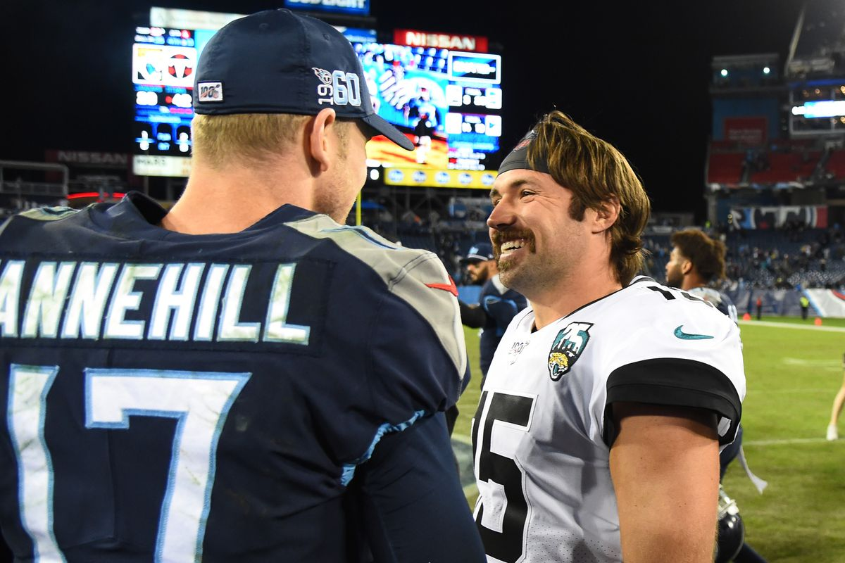 Jacksonville Jaguars quarterback Gardner Minshew talks with Tennessee Titans quarterback Ryan Tannehill after a Titans win at Nissan Stadium.