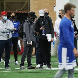 Pro scouts watch as quarterback Zach Wilson throws during BYU pro day in Provo on Friday, March 26, 2021.