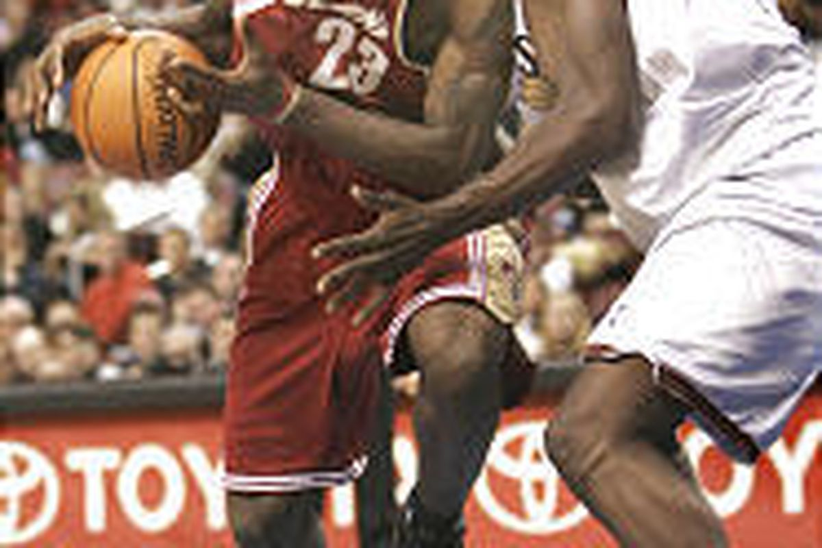Cleveland's LeBron James drives past Philadelphia's Chris Webber for two of his 36 points Saturday.