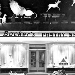 A landmark on South Temple is Mrs. Backer's Bakery, shown ready for Christmas in 1947.