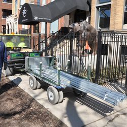 Contractor cart hauling supplies on the Sheffield sidewalk -