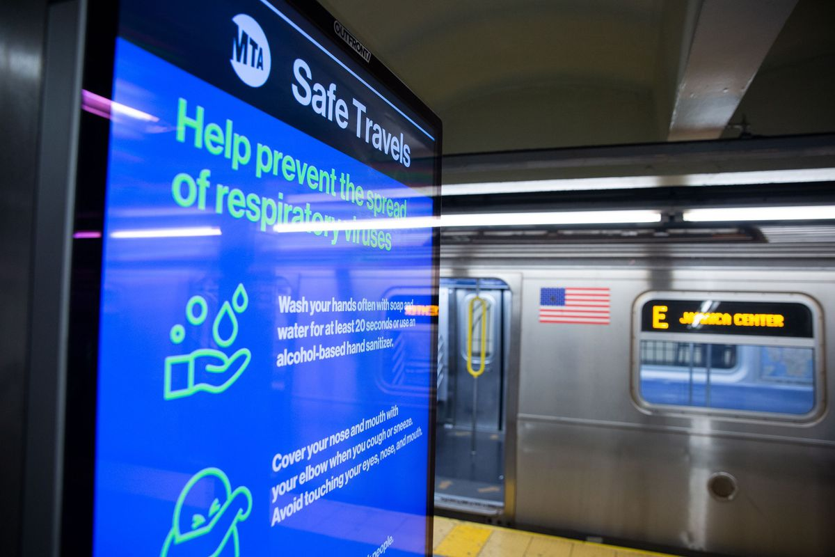 A digital advertisement at the World Trade Center E train station encourages safety measures for riders trying to stop the spread of the coronavirus.