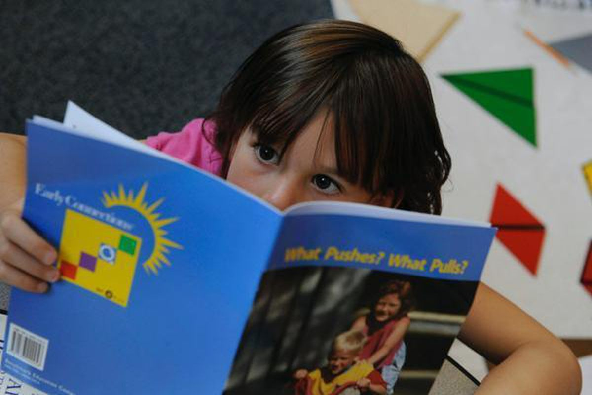 Eva Severance, a first-grader, concentrates on a reading lesson at Lincoln Elementary in Denver.