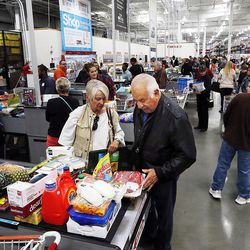 Ruth Wood and Michael Hunt move through the checkout area at Costco in Salt Lake City, Friday, Oct. 30, 2015. The store, located at 1818 S. 300 West, is the largest Costco in the world now that it has added a business center to its consumer store.