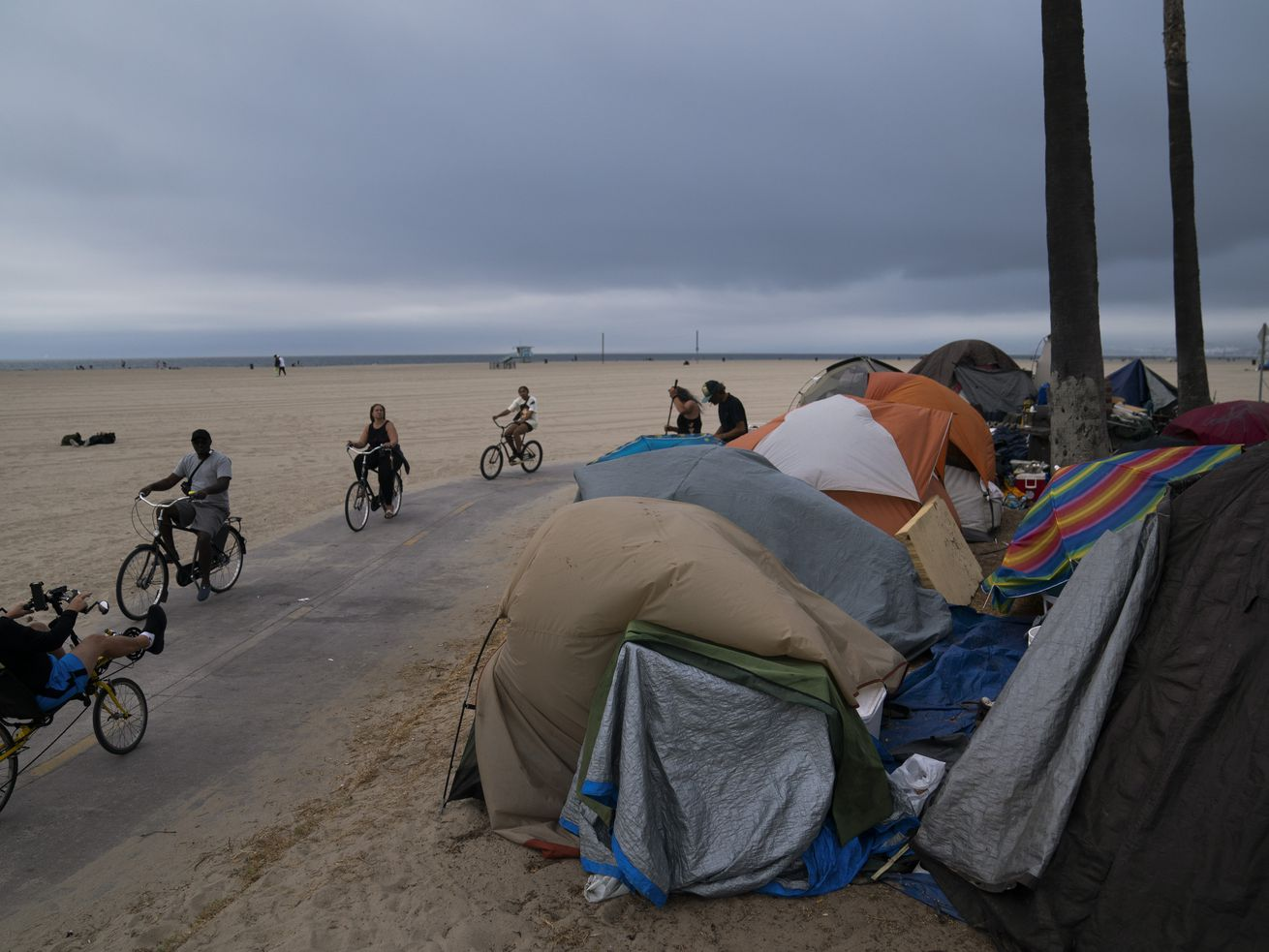 A homeless encampment set up along the boardwalk in the Venice neighborhood of Los Angeles in June 2021.